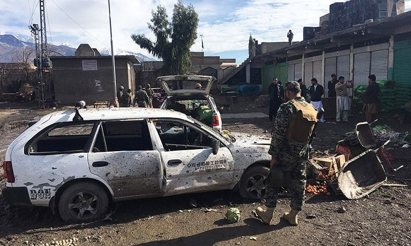Security officials inspect the bomb explosion site at a vegetable market in Parachinar. —AFP