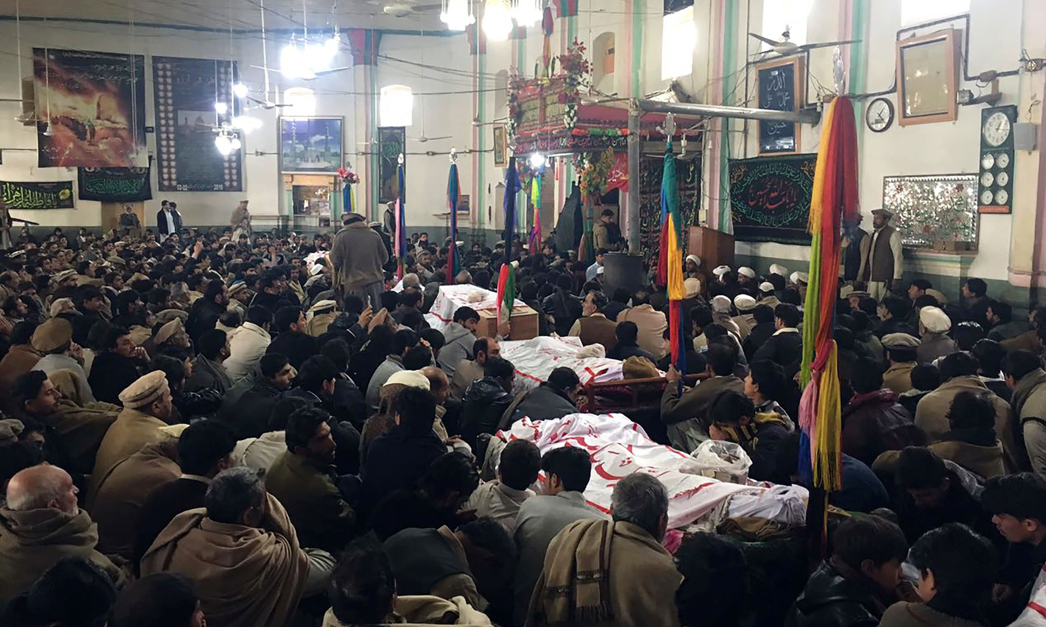 Mourners attend funeral prayers for the blast victims at a mosque in Parachinar city. —AFP