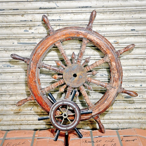 A SHIP and a speedboat's wheel for steering.