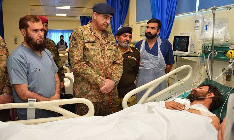 General Bajwa visiting wounded. -ISPR