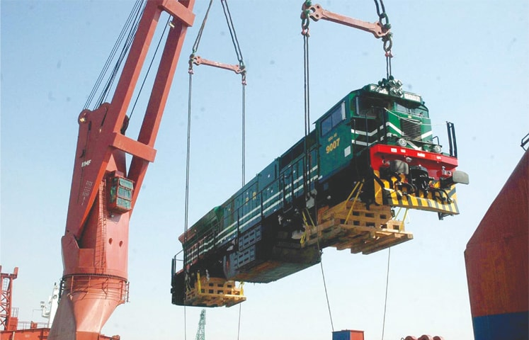 KARACHI : A locomotive being offloaded from a ship at the Karachi port on Monday.—APP