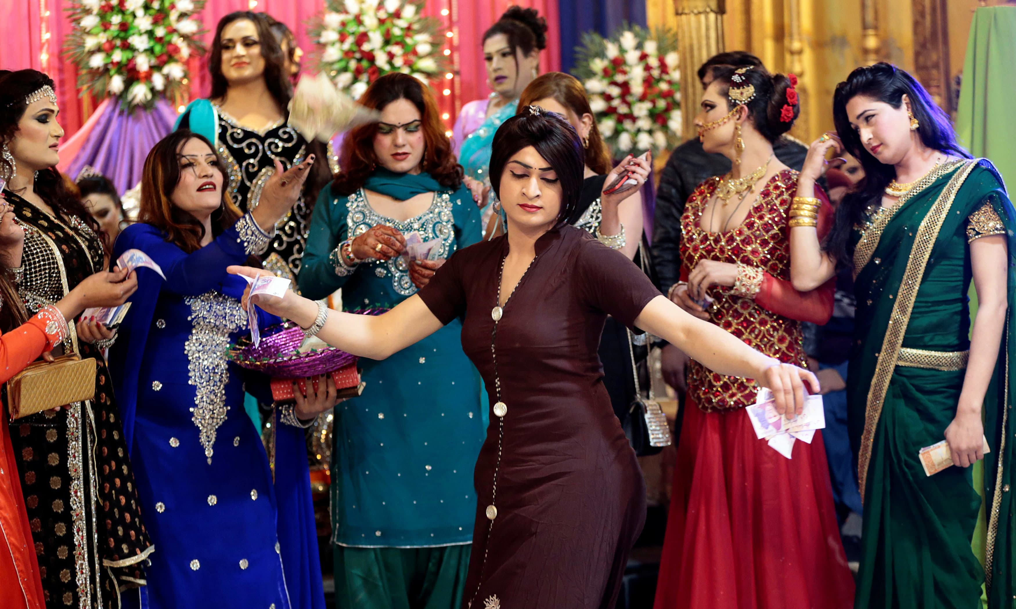 Members of the transgender community dance at Shakeela's party in Peshawar. —Reuters