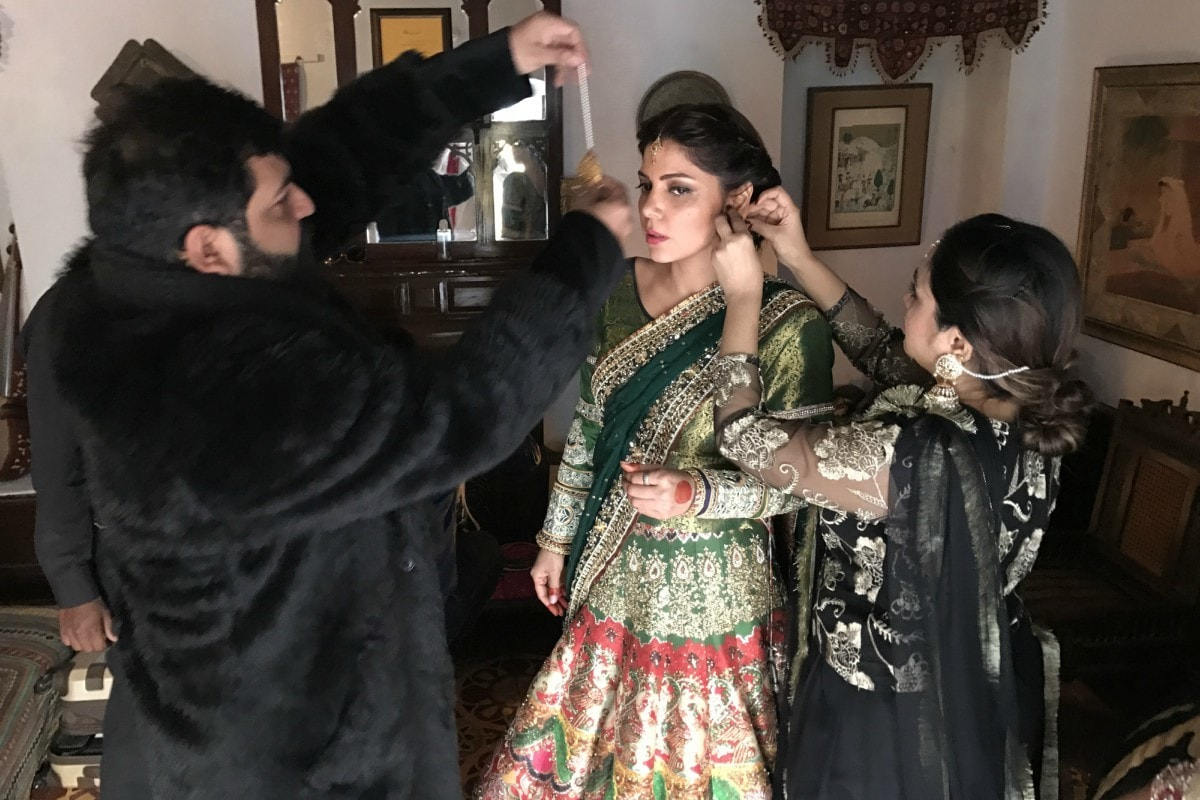 Hadiqa Kiani getting styled by Ali Xeeshan — Photo courtesy Raza Tirmize