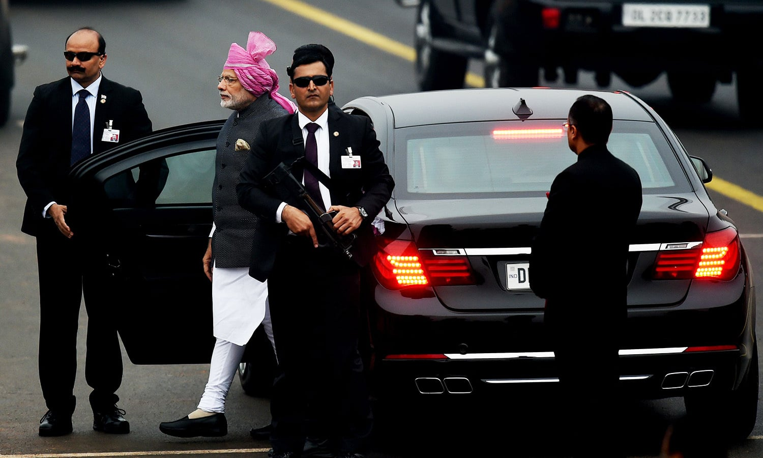 Indian Prime Minister Narendra Modi (2L) arrives ahead of the 68th Republic Day Parade in New Delhi.— AFP