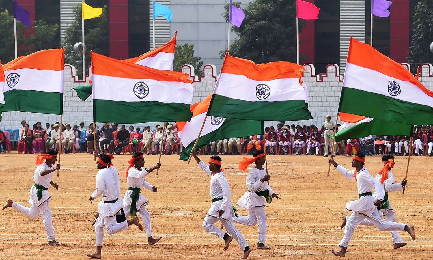 Indian school children take part in a cultural performance during an event to mark Republic Day at the Manek Shaw Parade Grounds in Bangalore.— AFP