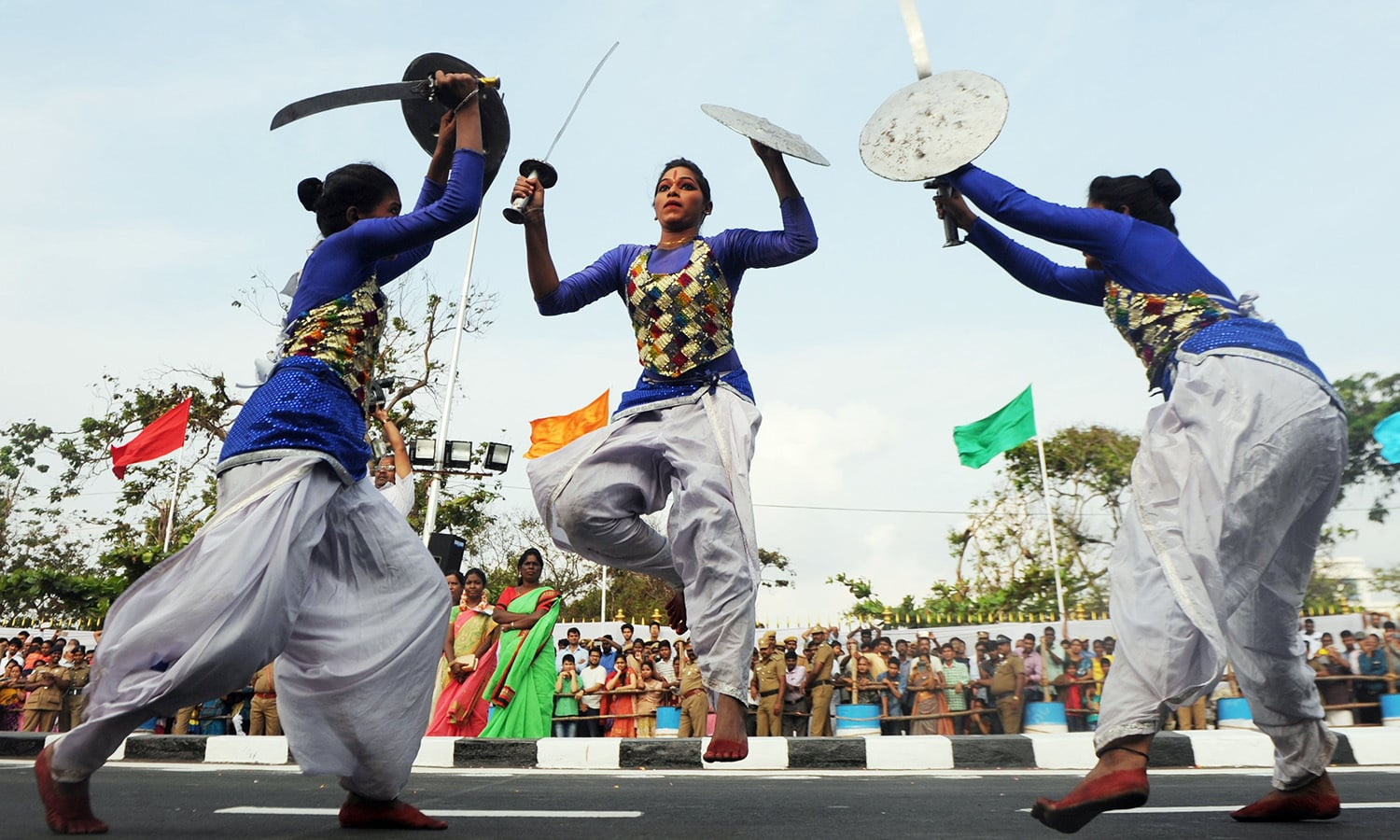Indian school students displays 'kalaripayittu', an ancient martial art, during a parade to mark Republic Day in Chennai.— AFP