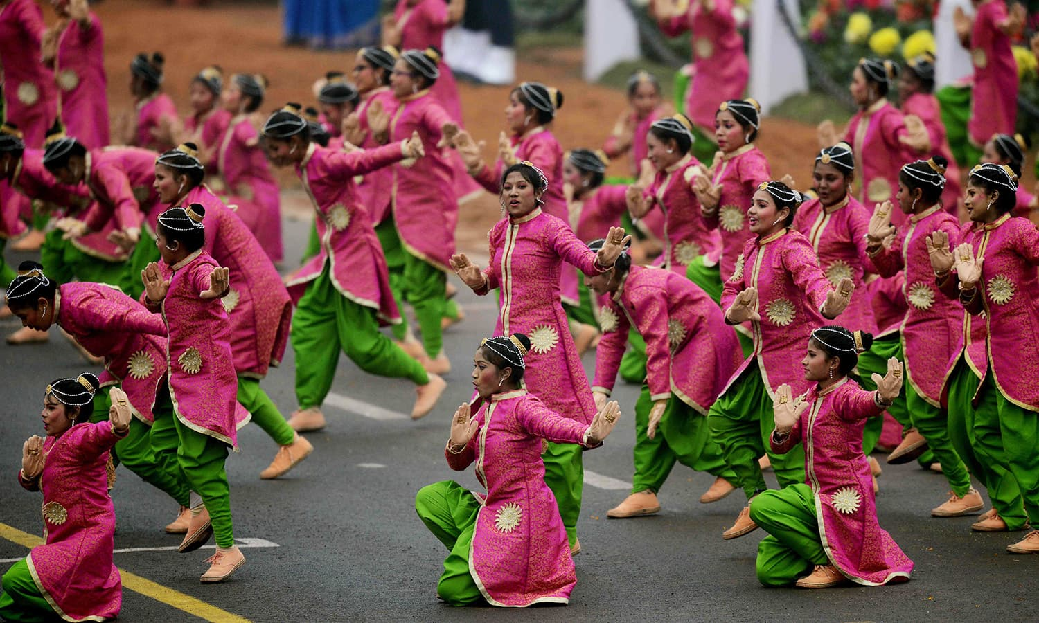 Indian school children perform during the 68th Republic Day parade in New Delhi.— AFP