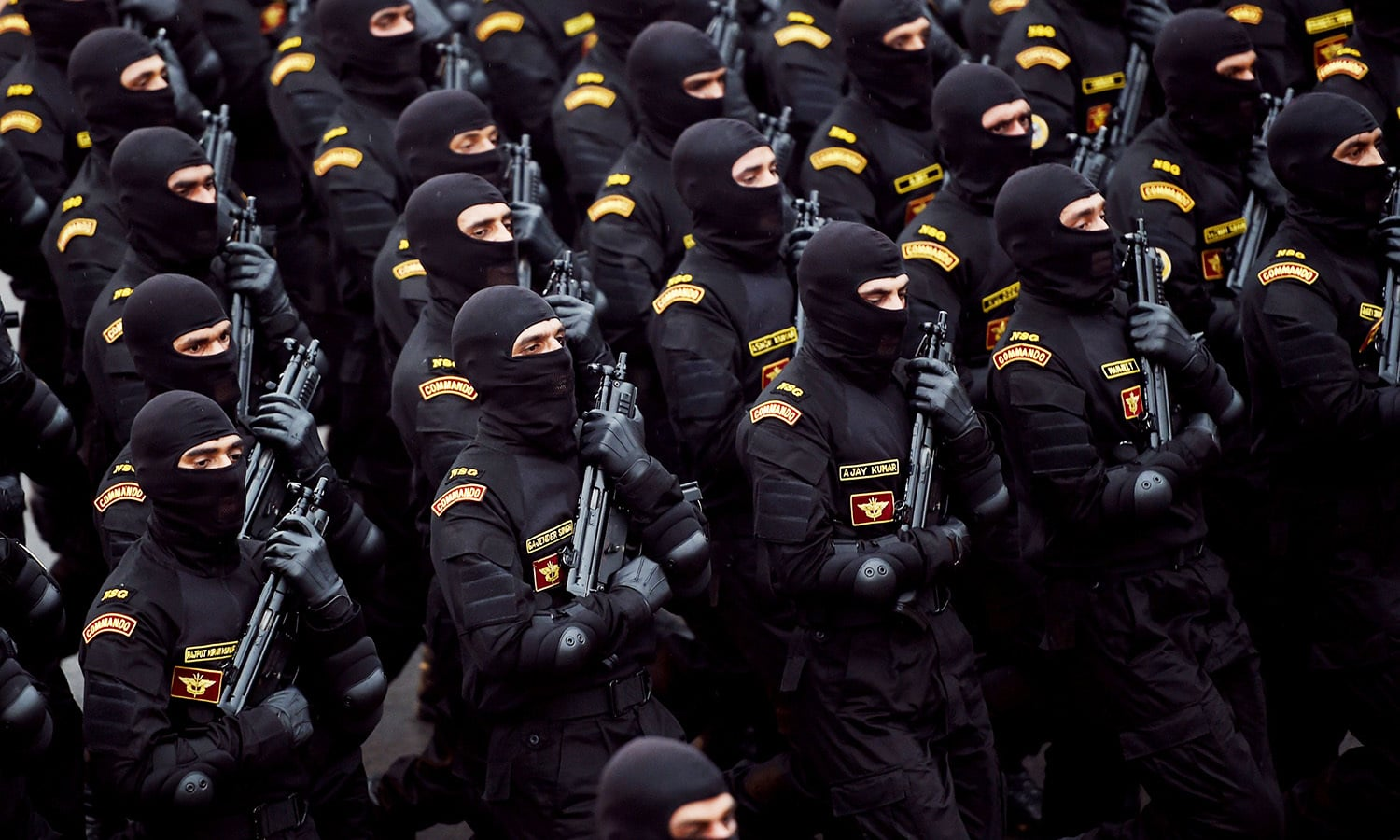 An Indian National Security Guard (NSG) Commandos contingent march during the parade in New Delhi.— AFP