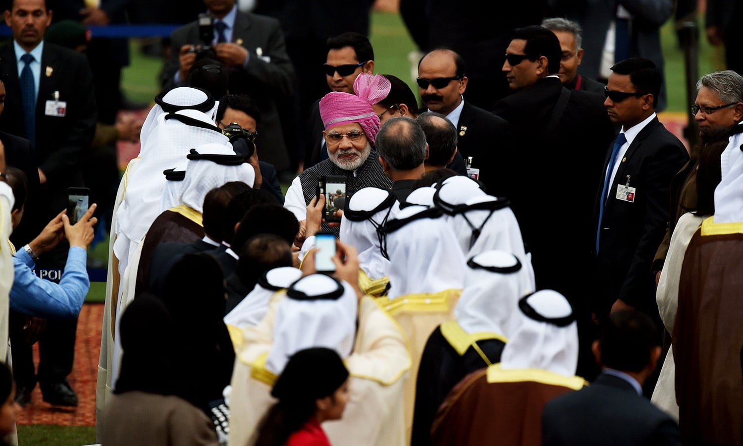Indian Prime Minister Narendra Modi (C) meet officials from the UAE during the 68th Republic Day celebrations.— AFP