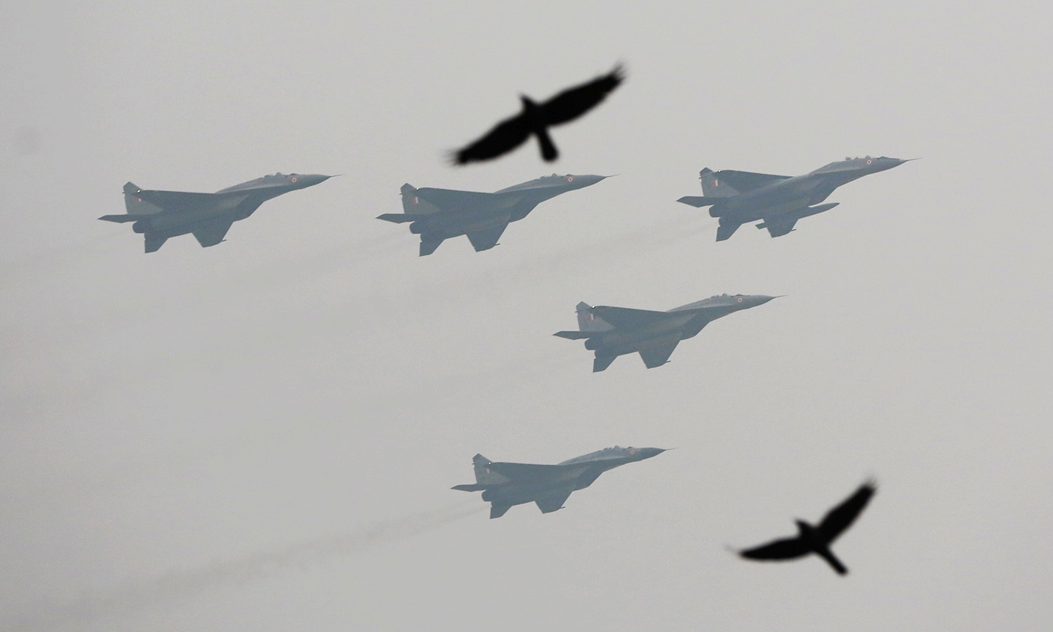 Indian Air Force's fighter planes fly past during the Republic Day parade in New Delhi.— Reuters