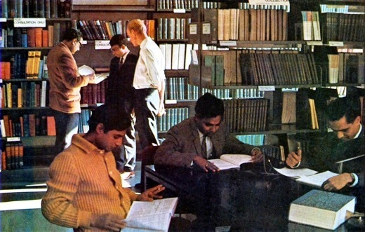 Abdus Salam with his peers at the ICTP library. Photo - ICTP