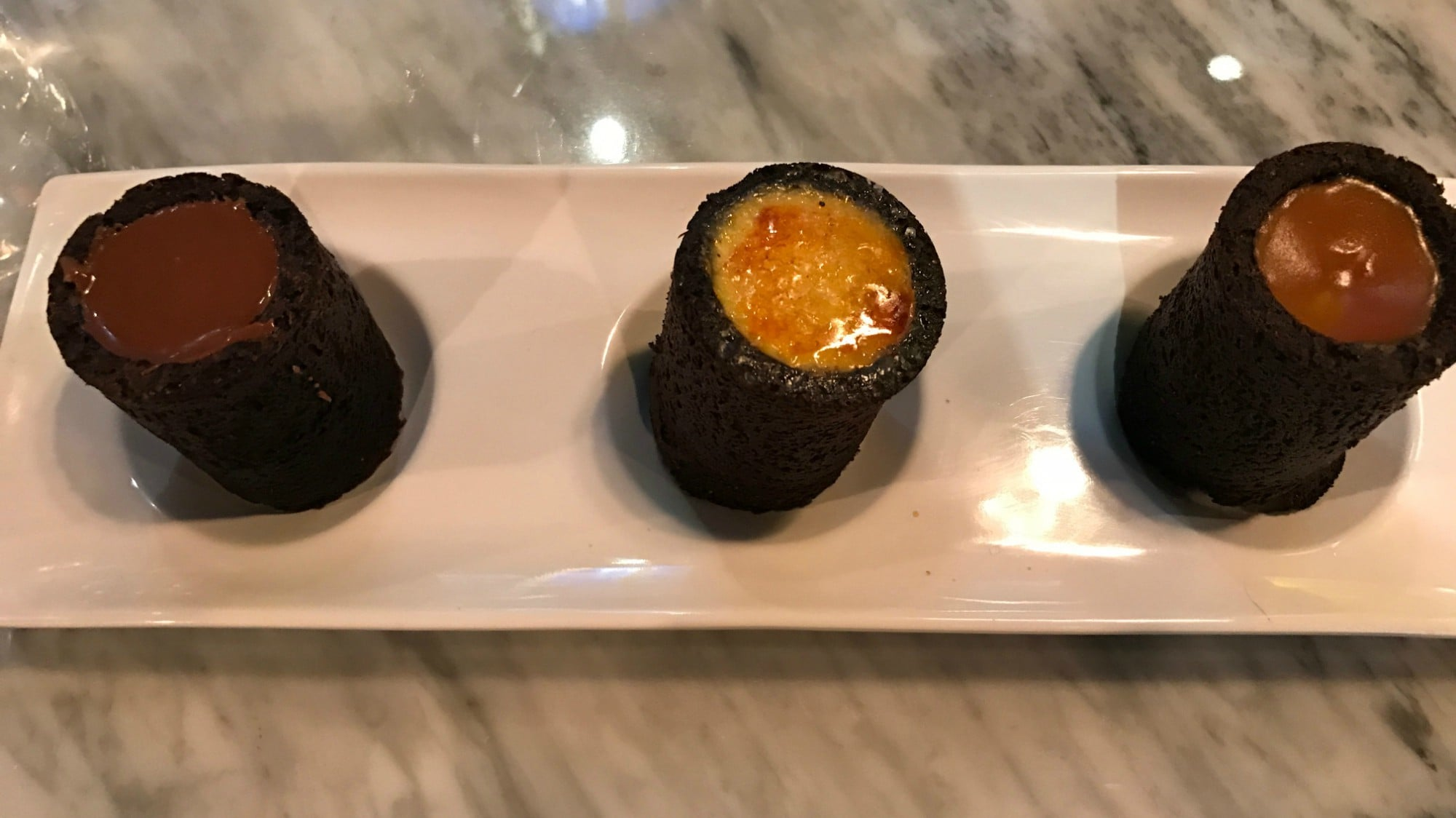 Brownie Shots arrive as a trio of flavours on a plate