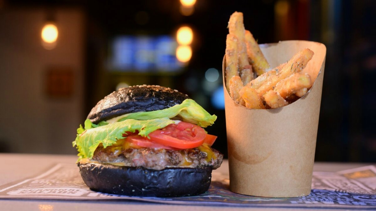 Street Burger's eponymous burger features a juicy beef patty sandwiched in an ebony bun