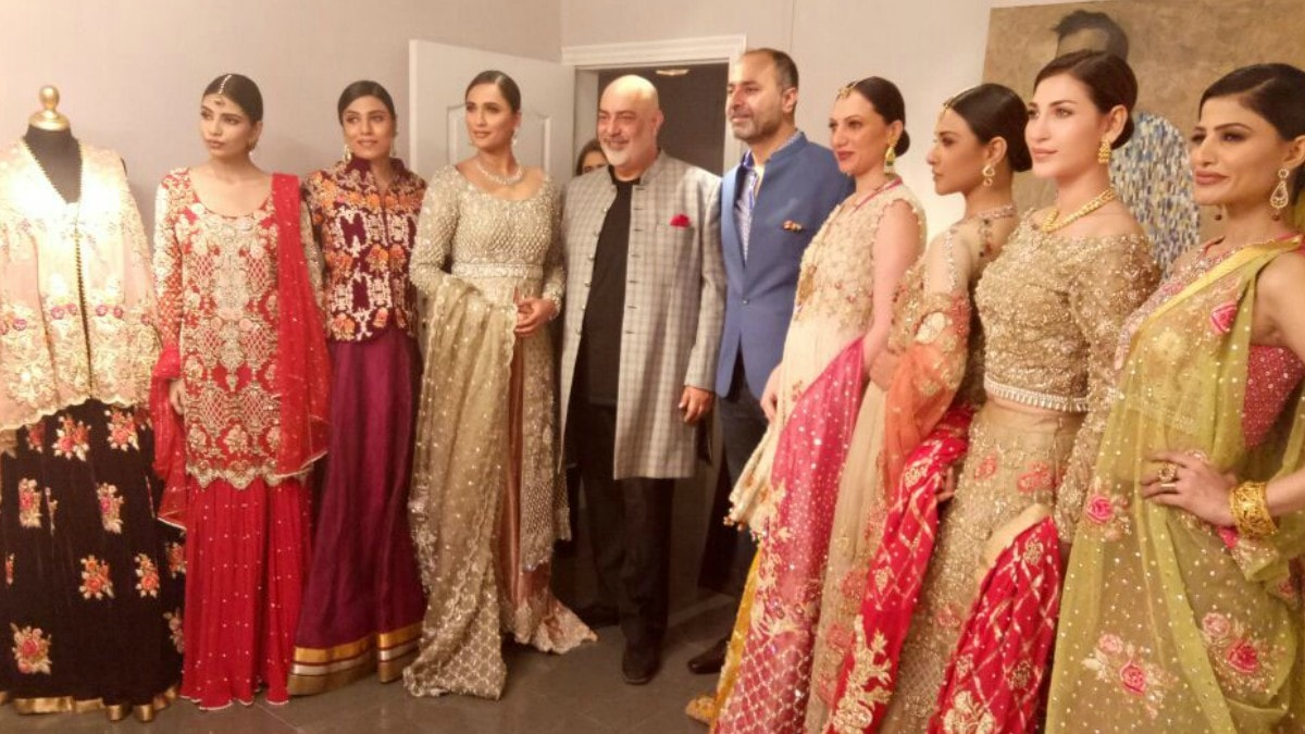 Deepak with Tariq Amin and models wearing his designs