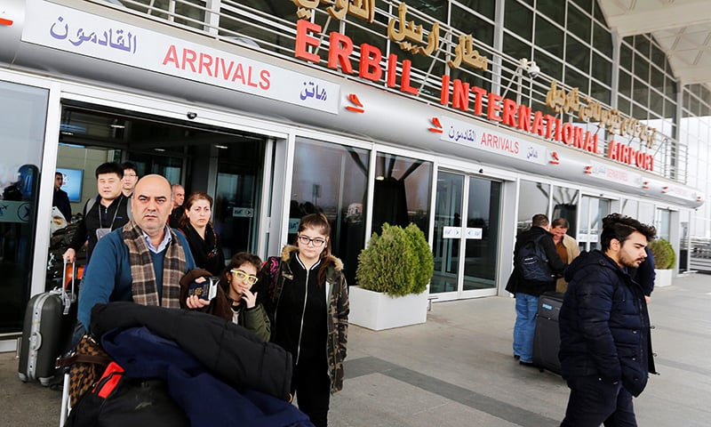 Fuad Sharef Suleman and his family push their luggage after returning from Cairo to Erbil, after US President Donald Trump's decision to temporarily bar travellers from seven countries, including Iraq. ─ Reuters