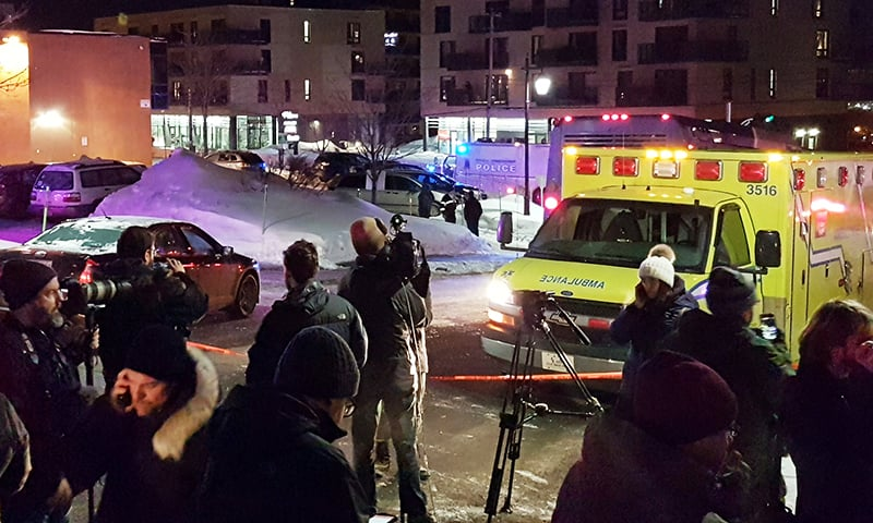 An ambulance is parked at the scene of a fatal shooting at the Quebec Islamic Cultural Centre in Quebec City, Canada January 29.— Reuters