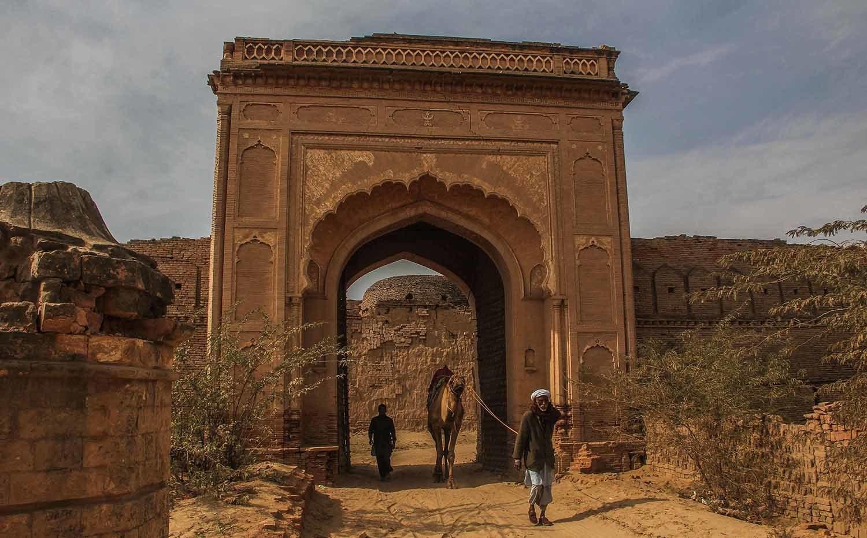 A local makes his way through the outermost gate of Derawar Fort amid the Cholistan desert, Bahawalpur.─Fazal Khaliq