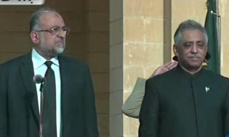 SHC Chief Justice Syed Sajjad Ali Shah and PML-N's Muhammad Zubair at the oath-taking ceremony in Karachi. ─ DawnNews