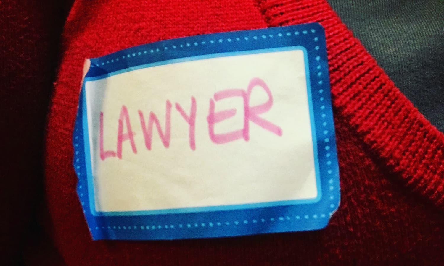 "My friend Elleni and I wrote ""lawyer"" on name tags for people at the airport who needed help to be able to approach us."