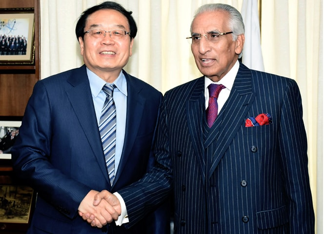 Special Assistant to the PM on Foreign Affairs Syed Tariq Fatemi shakes hands with Chinese State Commissioner for Counter Terrorism and Security Cheng Guoping prior to their meeting on Monday.