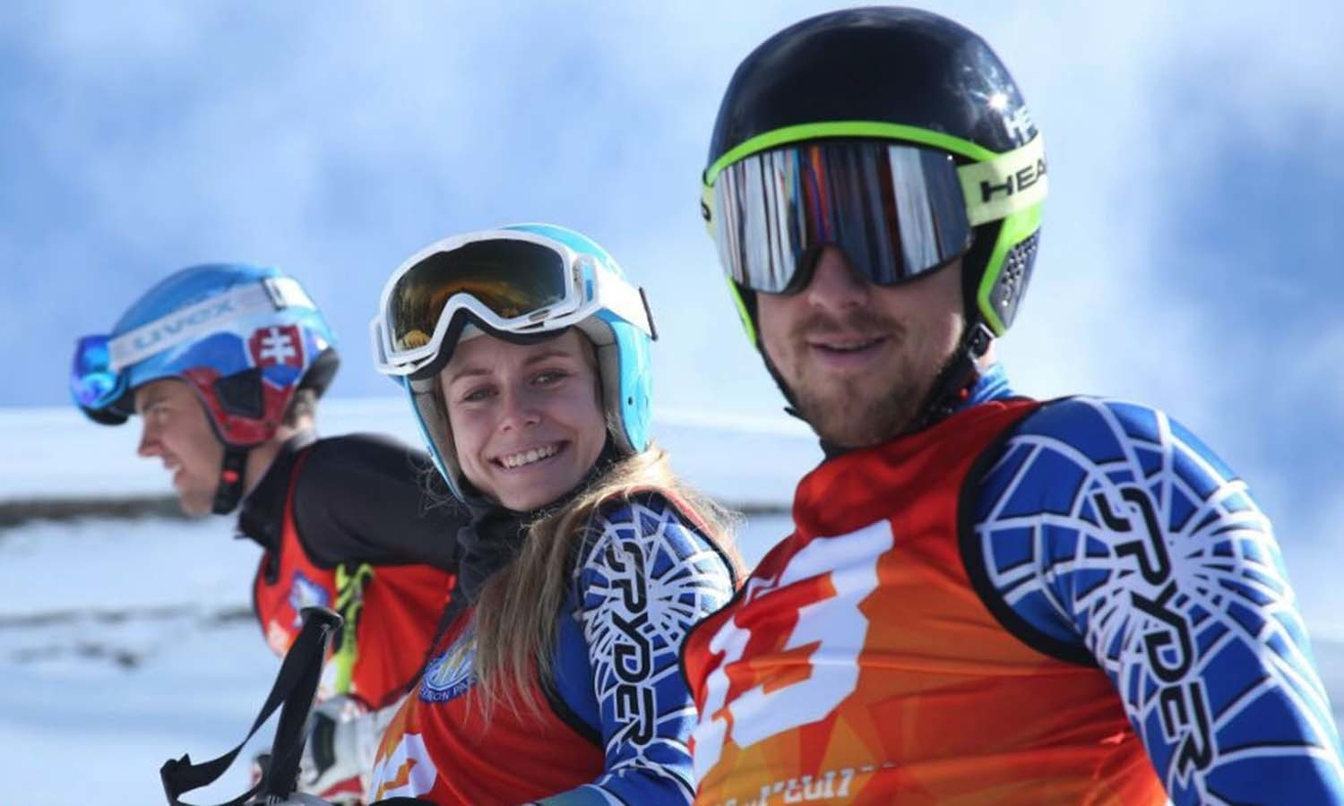 International skiers smile for the camera. ─ Photo courtesy ISPR