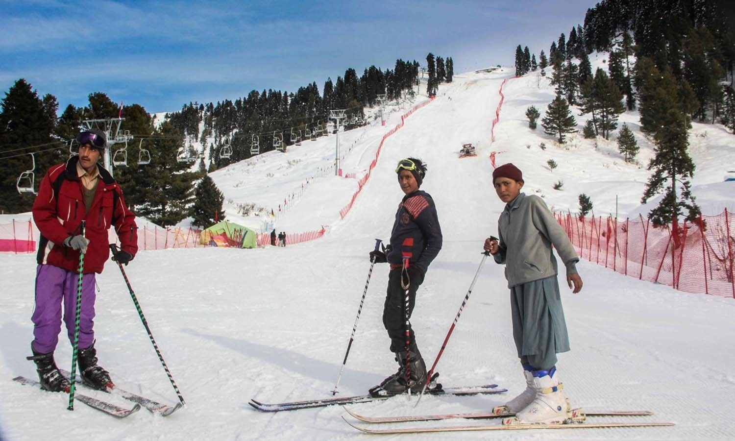 Local skiiers stand at the foot of the slope. ─ Photo by author