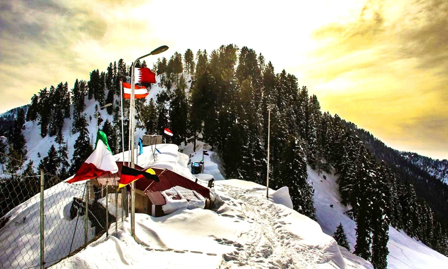 Flags of participating countries hoisted at the hill station. ─ Photo by author