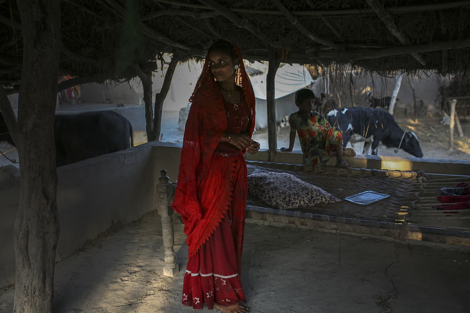 Lakhsmi's younger daughter, Rani, inside her house in a village near Mirpurkhas.