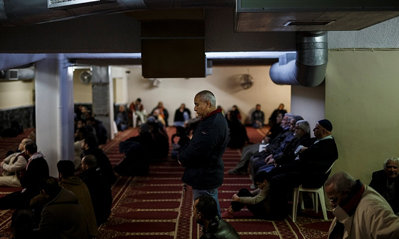Muslims living in Greece attend Friday prayers at the Masjid Al-Salam makeshift mosque in Athens. ─Reuters