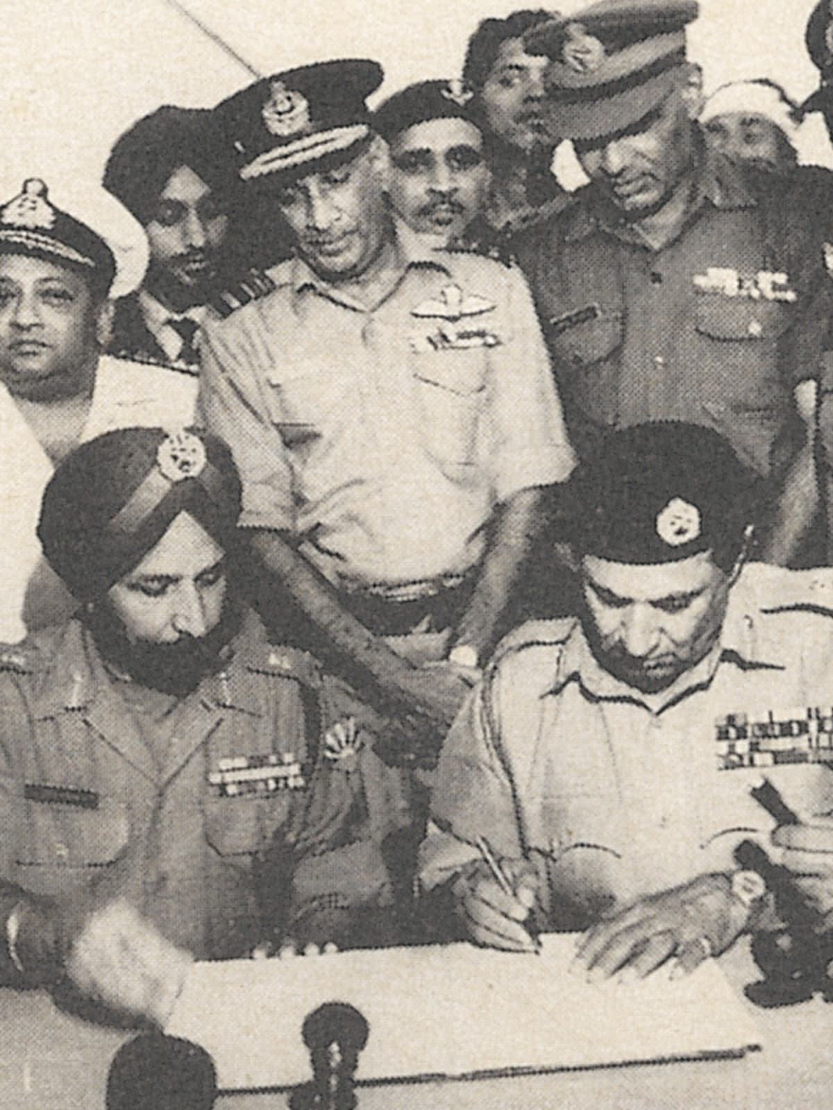 Lieutenant-General Niazi signs the Instrument of Surrender in Dhaka | White Star Archives