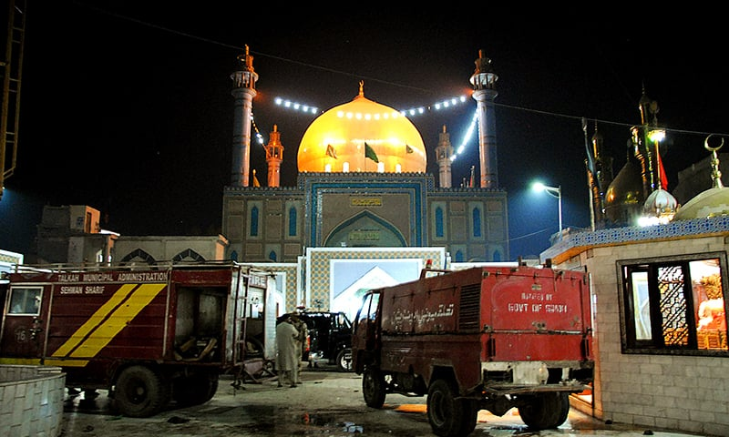 Fire tenders seem at the shrine Sufi saint Lal Shahbaz Qalandar after the bombing. -AFP