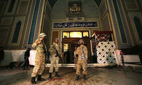 Soldiers standing after the suicide attack at shrine of Lal Shahbaz Qalandar. —APP