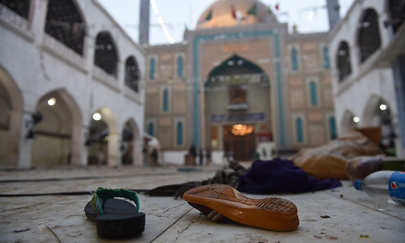 Slippers of blast victims lie on the ground at the 13th century Muslim Sufi shrine of Lal Shahbaz Qalandar. ─AFP