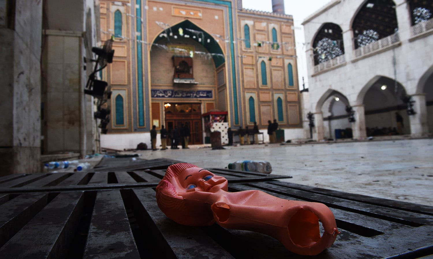 A doll lies on the ground of in the premises of the 13th century Muslim Sufi shrine of Lal Shahbaz Qalandar following the attack. ─AFP