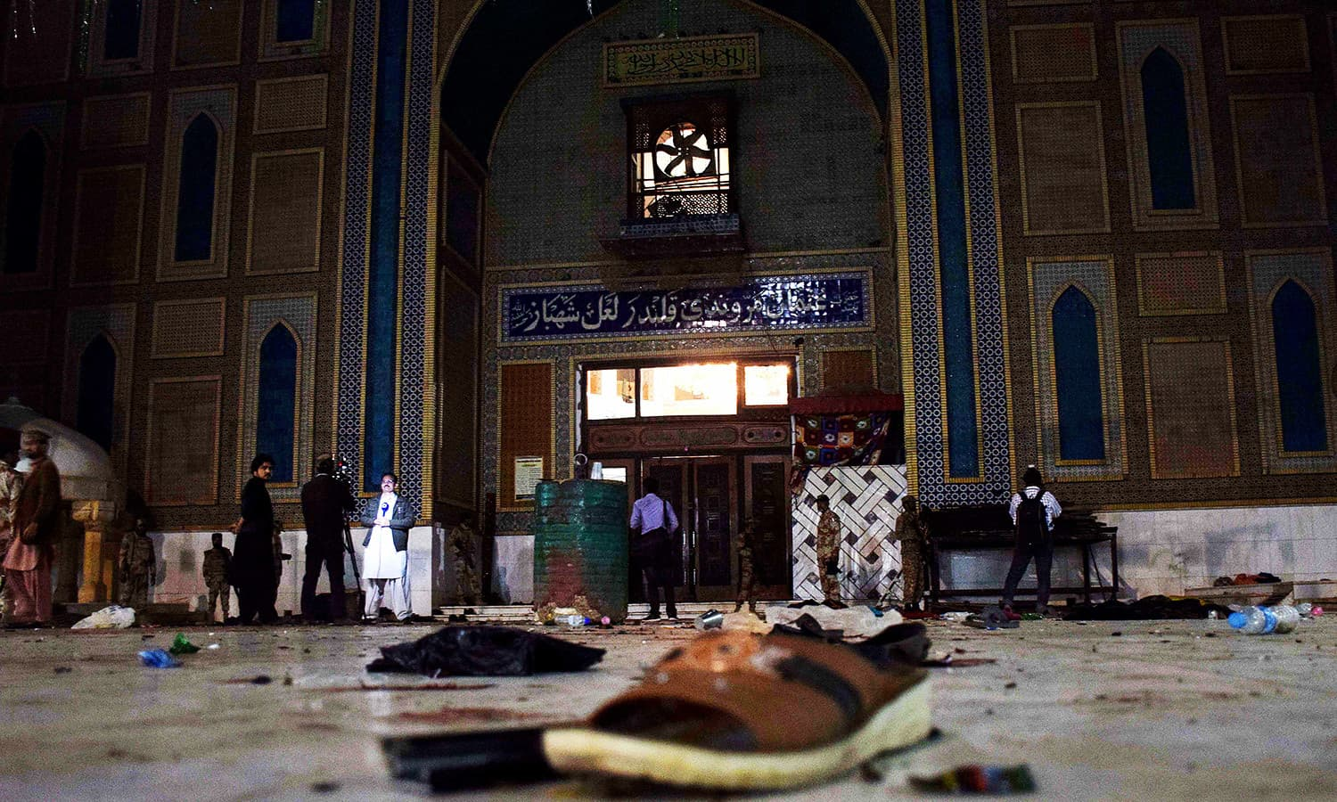 Slippers of devotees lie on the floor as soldiers cordon off shrine of 13th century Muslim Sufi Saint Lal Shahbaz Qalandar following the blast. ─AFP