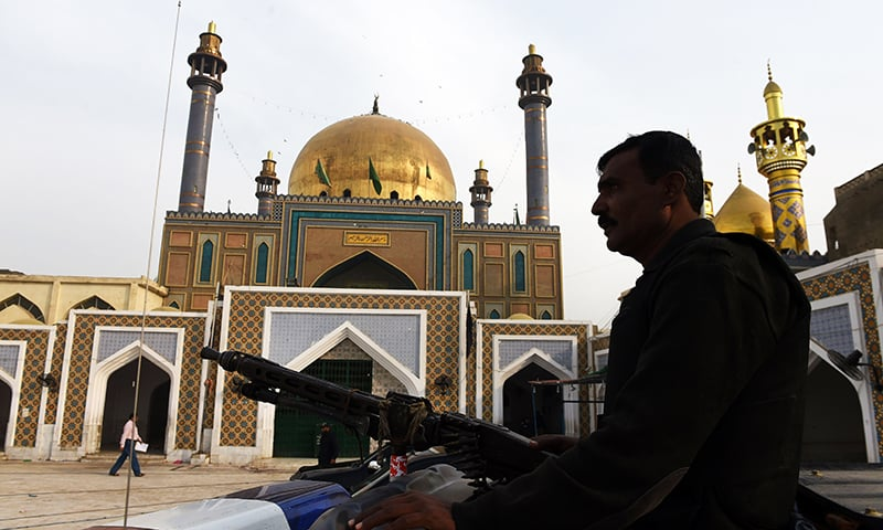 Pakistani security personnel deployed outside the shrine of Lal Shahbaz Qalandar. -AFP