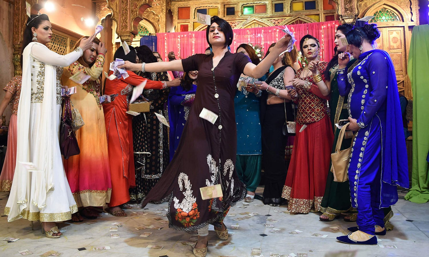 Members of the Pakistani transgender community dance at a party in Peshawar.─AFP