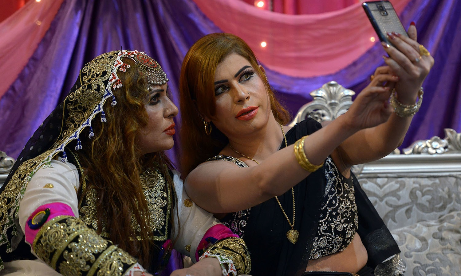 Members of the Pakistani transgender community attend a party in Peshawar.─AFP