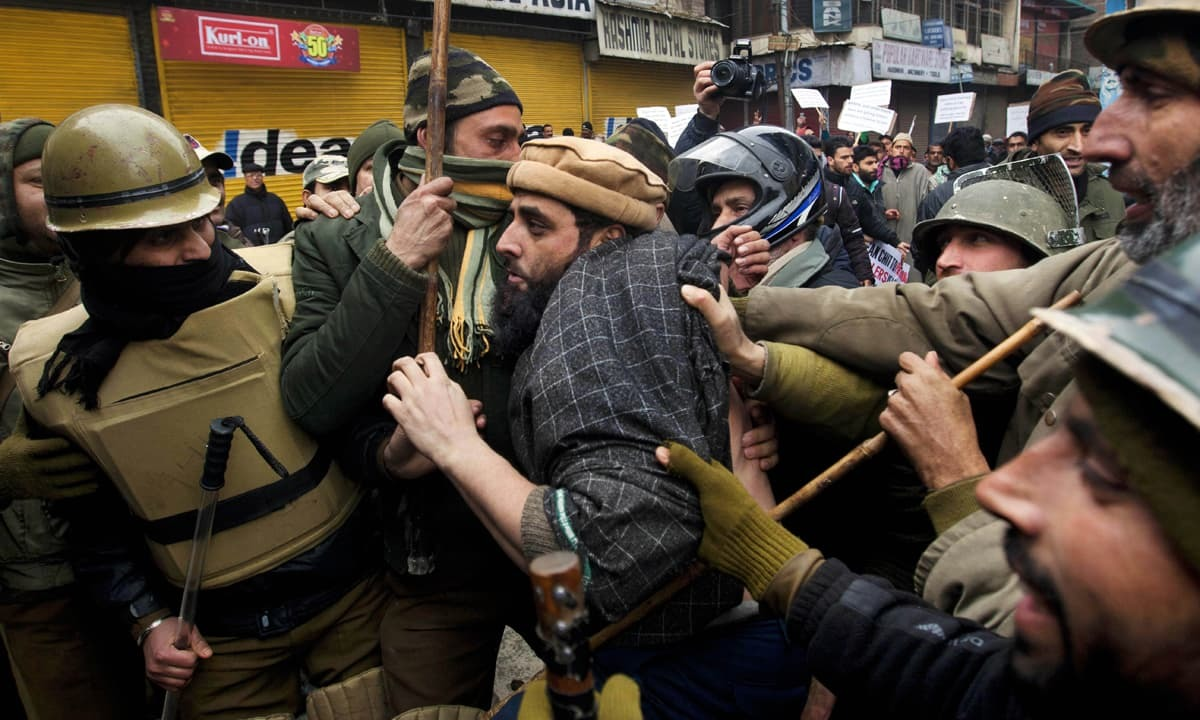 Indian policemen detain JKLF activists during a protest against the Indian army in Srinagar | AP