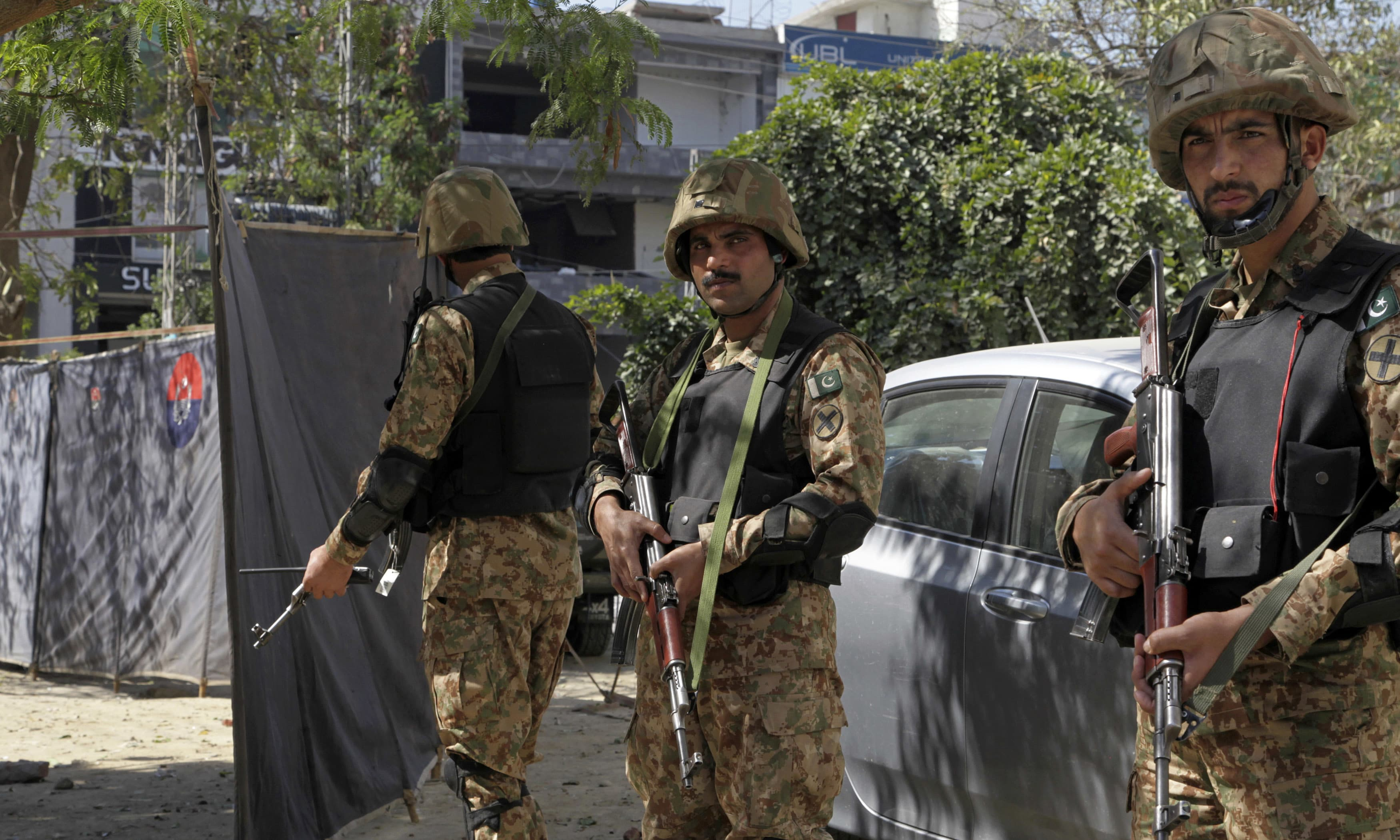 Soldiers stand alert at the site of an explosion in Lahore. —AP