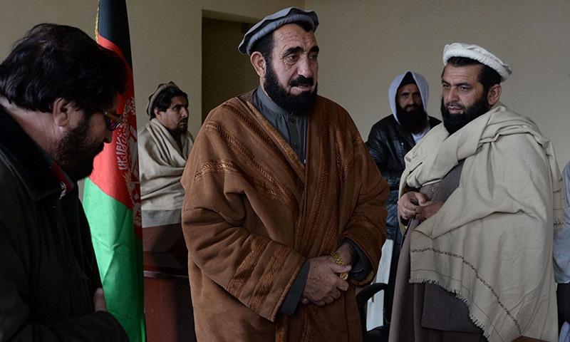 Haji Ghalib speaks with tribal elders in his office in Bati Kot.─ AFP