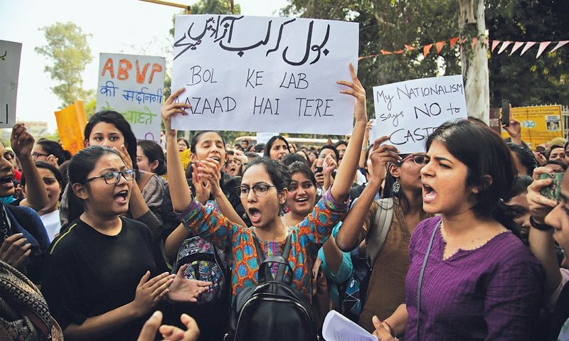 Indian students rally after woman threatened with rape