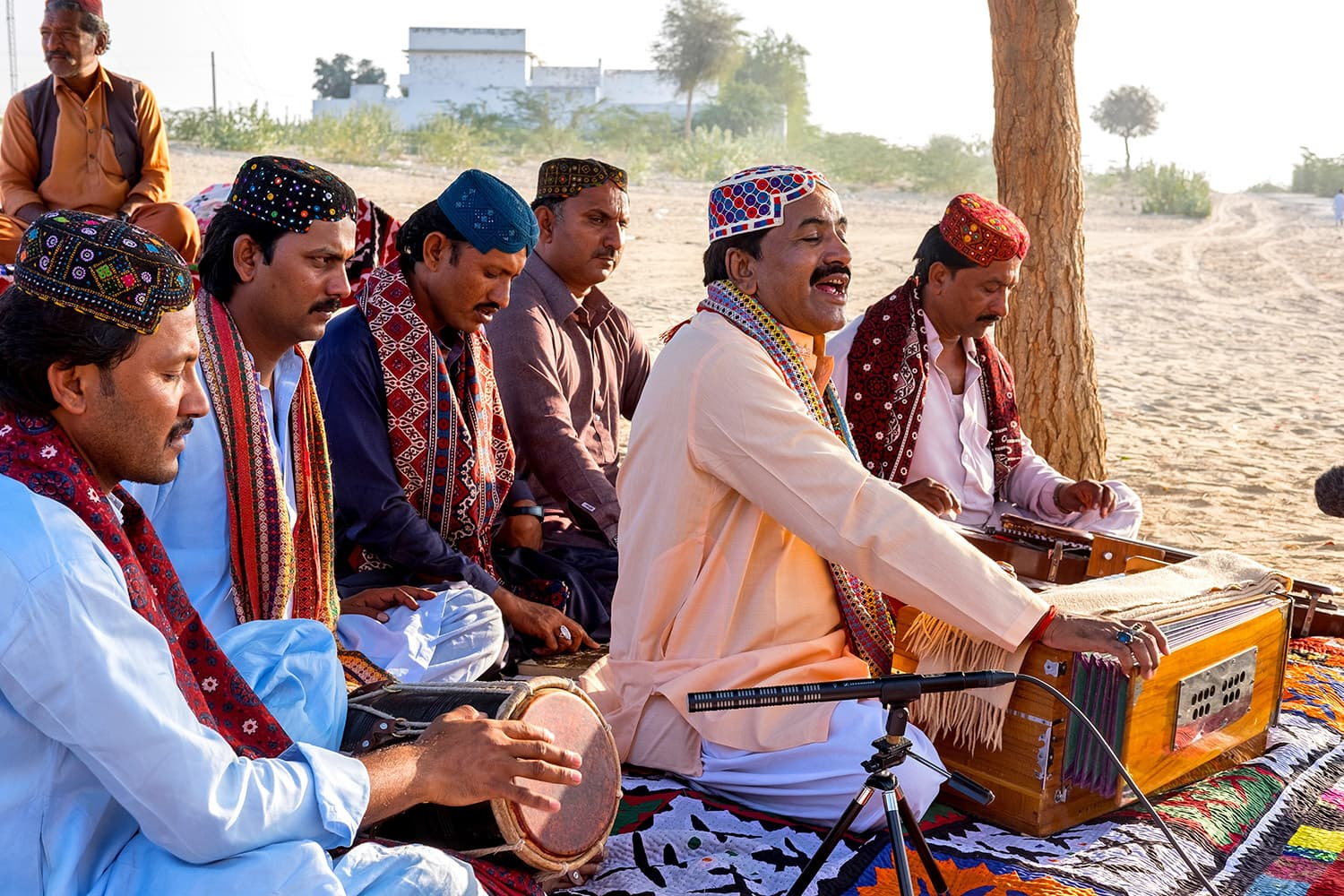 Shafi Faqir singing songs about the love of native soil and peace.