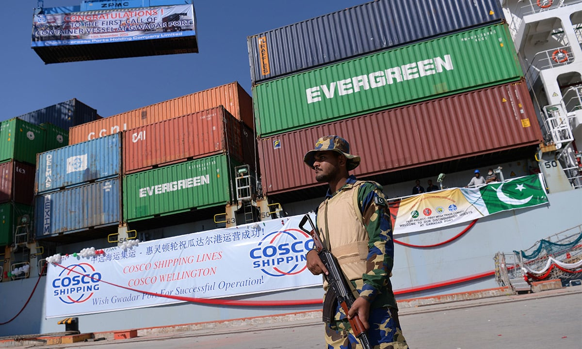 A navy official stands guard in front of the Cosco Wellington ship   AFP