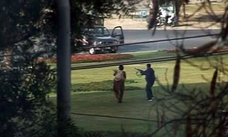 An image from a TV broadcast shows gunmen firing in the direction of a police vehicle.— Reuters