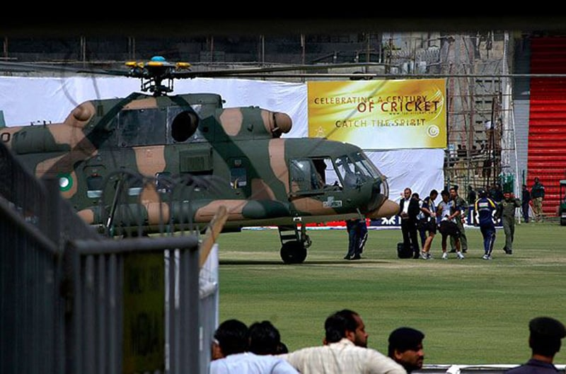 Sri Lankan officials and players prepare to board into a helicopter at Qadhafi stadium after the shooting.— AP