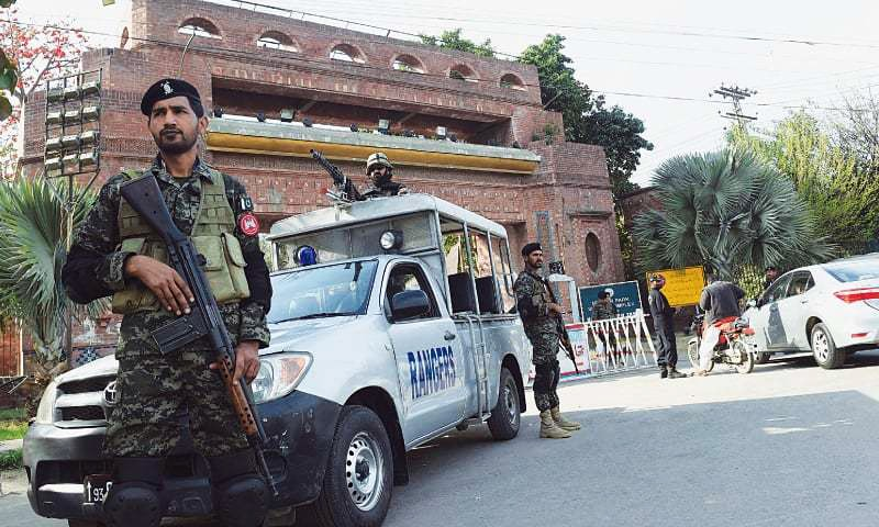 LAHORE: Paramilitary soldiers stand guard at an entry gate of the Gaddafi Stadium on Friday ahead of the PSL final.— AFP