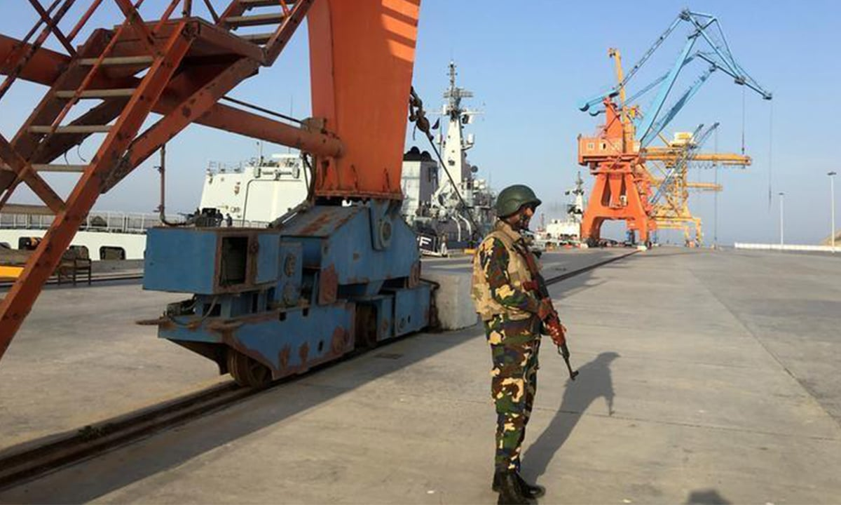 A soldier stands guard at the port  REUTERS