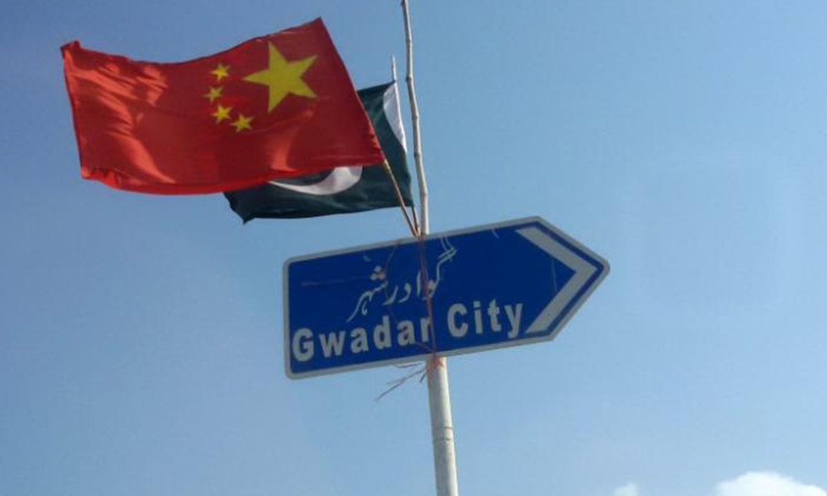 The Pakistani and Chinese flags fly on a sign along a road towards Gwadar|Reuters