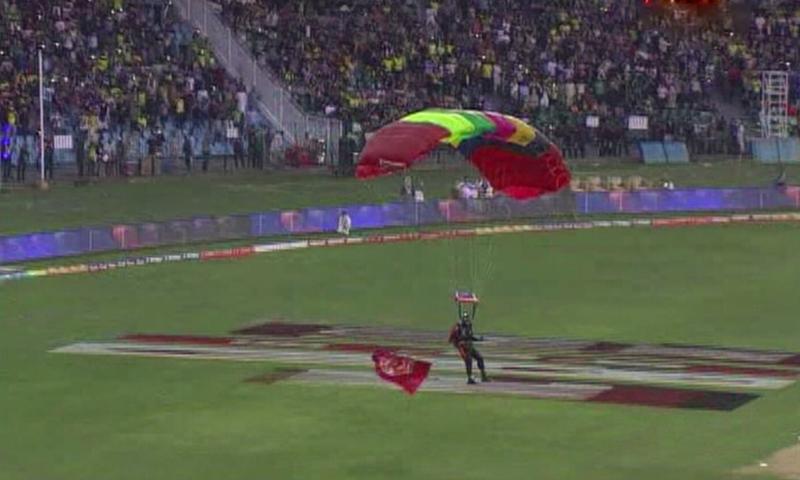 A parachutist lands at Gaddafi Stadium. ─ DawnNews